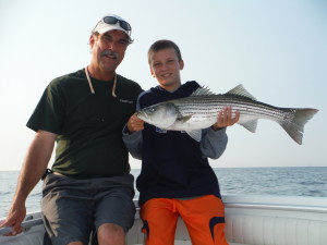 Dylan and Mike with striper